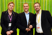 Picture of the winner Ulf Hjerppe, together with Rebecca Stromeyer (ICWE) and Clive Young.