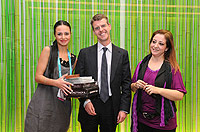 Özge Karaoğlu (left) and Havva Kangal Erdoğan (right), after receiving their award from Tobias Hall from Avid (Germany)(middle)