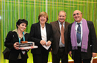 Gina Mango (left), Carmelo Mario Martino and Vincenzo Ciminelli (right), after receiving their award from Maruja Gutierrez-Diaz from the European Commission (middle)