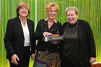 Lisette Meijrink and Marion Stevens (right) after receiving their prizes from Maruja Gutierrez-Diaz from the European Commission (left)
